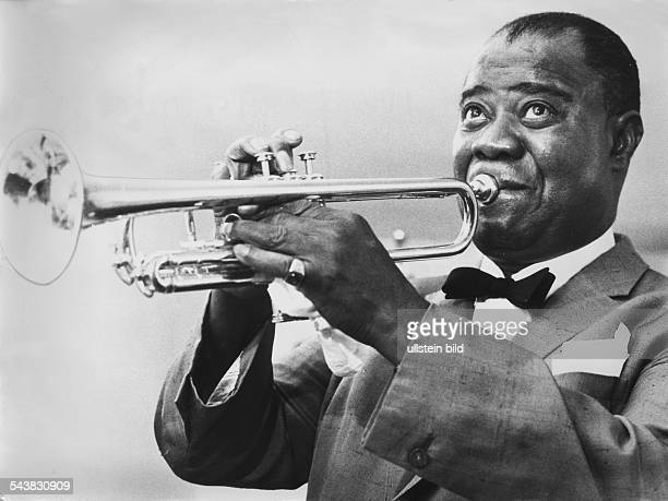 Armstrong Louis *Jazz trumpeter and singer USAplaying the trumpet undated