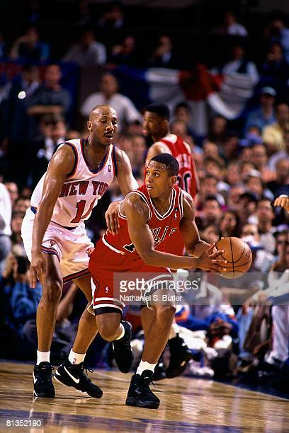 J Armstrong of the Chicago Bulls looks to move the ball against Derek Harper of the New York Knicks in Game Seven of the Eastern Conference...