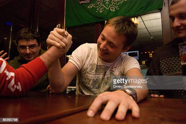 Arm-wrestling in pub
