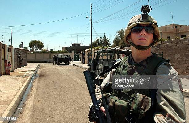 S Army 101st Airborne 3rd Battalion 502nd Infantry Private First Class Kevin Houcek from Wheaton IL provides covers over an Iraqi block as his squad...