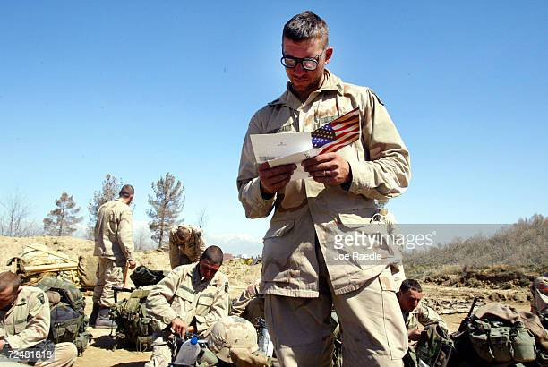 S Army 101st Airborne Division SPC Jason Boudreaux from Odessa Texas reads a card from his aunt and uncle March 12 2002 after his unit returned to...
