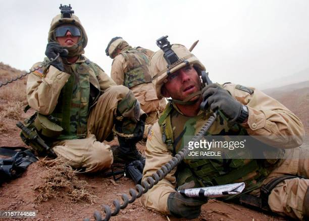 US Army 10th Mountain soldiers direct mortar fire on enemy positions 09 March 2002 near the villages of Sherkhankheyl Marzak and Bobelkiel...