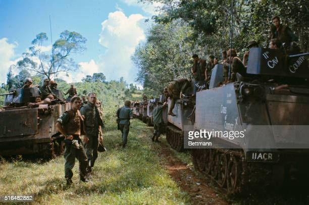US Army 11th Armored Cavalry Regiment tanks and personnel carriers move inside the Cambodian border