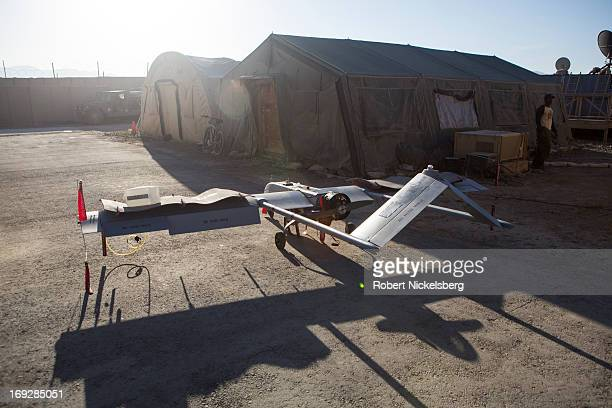 Army 14' Shadow surveillance drone is parked near a hangar at Forward Operating Base Shank May 8, 2013 in Logar Province, Afghanistan. The Shadow...