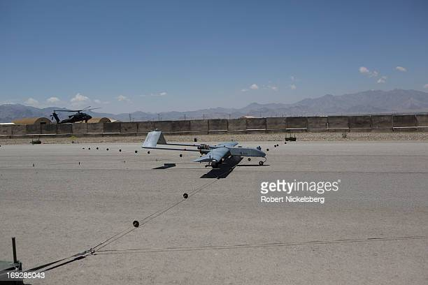 Army 14' Shadow surveillance drone lands at Forward Operating Base Shank May 8, 2013 in Logar Province, Afghanistan. The Shadow drone is remotely...