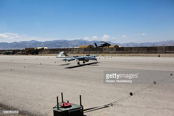 Army 14' Shadow surveillance drone lands at Forward Operating Base Shank May 8 2013 in Logar Province Afghanistan The Shadow drone is remotely...