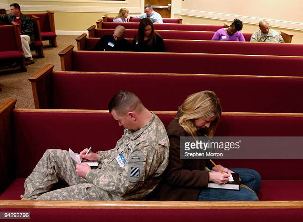 Army 1st Heavy Brigade Combat Team Captain Bob Kolb and his wife Lisa Kolb fill out commitment cards as part of the Coin and Covenant Ceremony...