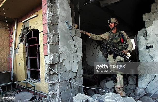S Army 1st Infantry Division 2nd Battalion2nd Regiment Sergeant John Bandy from Little Rock Arkansas helps his squad sweep a neighborhood of...