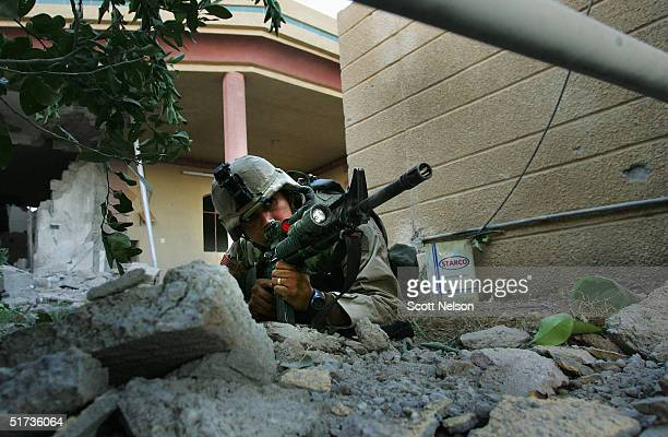S Army 1st Infantry Division 2nd Battalion2nd Regiment Specialist Marcos Chavez from Los Angeles California takes aim from a cover position November...
