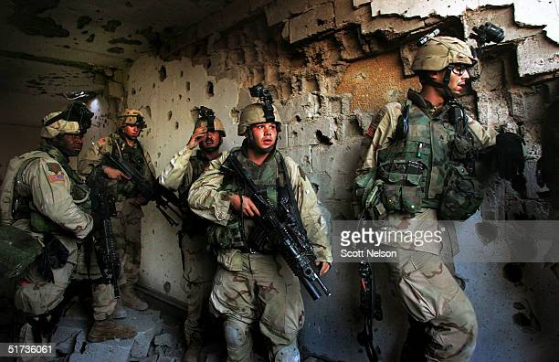 S Army 1st Infantry Division 2nd Battalion2nd Regiment troops clear a neighborhood of remaining insurgent fighters November 12 2004 during fighting...
