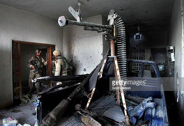 S Army 1st Infantry Division 2nd Battalion2nd Regiment troops locate an enemy truck mounted heavy machine gun during a sweep of a neighborhood for...