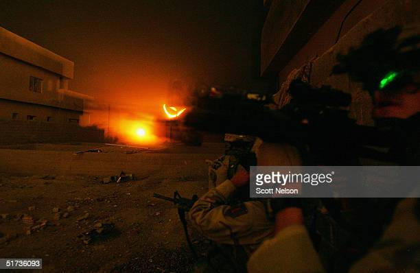 S Army 1st Infantry Division 2nd Battalion2nd Regiment troops move to sweep a neighborhood of remaining insurgent fighters November 11 2004 during...