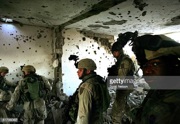 S Army 1st Infantry Division 2nd Battalion2nd Regiment troops sweep a bombed out building searching for remaining insurgent fighters November 12 2004...