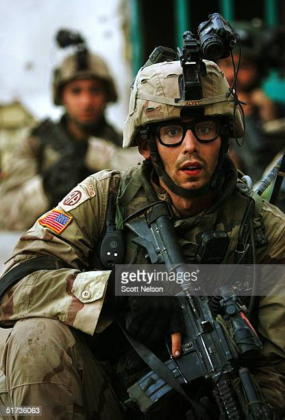 S Army 1st Infantry Division 2nd Battalion2nd Regiment troops sweep a neighborhood of remaining insurgent fighters November 12 2004 during fighting...