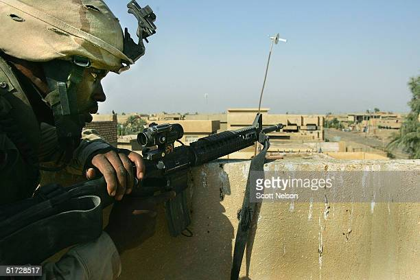 S Army 1st Infantry Division's 2nd Battalion2nd Regiment Specialist Arthur Wright V keeps watch for insurgent fighters November 10 2004 during...
