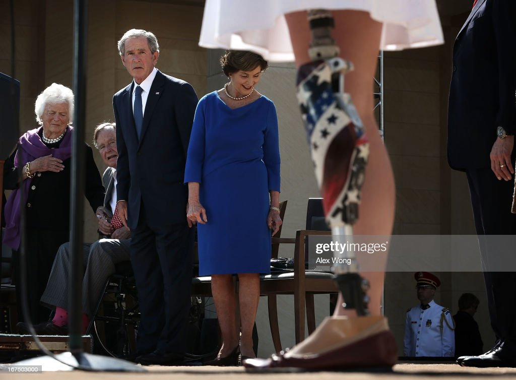 U.S. Army 1st Lt. Melissa Stockwell (Ret.) (R), who was the first female American soldier to lose a limb in the war in Iraq, recites the Pledge of Allegiance as (L-R) former U.S. first lady Barbara Bush, former President George H.W. Bush, former President George W. Bush and former first lady Laura Bush look on during the opening ceremony of the George W. Bush Presidential Center April 25, 2013 in Dallas, Texas. The Bush library, which is located on the campus of Southern Methodist University, with more than 70 million pages of paper records, 43,000 artifacts, 200 million emails and four million digital photographs, will be opened to the public on May 1, 2013. The library is the 13th presidential library in the National Archives and Records Administration system.