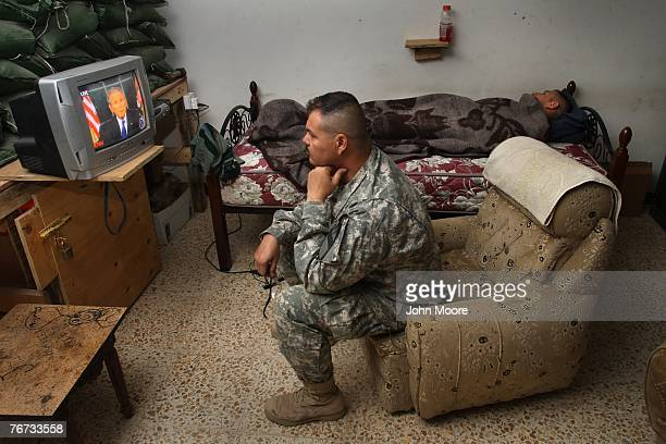 S Army 1st Sgt Kenny Power from Lajas Puerto Rico watches television as US President George W Bush makes an address concerning the war September 14...