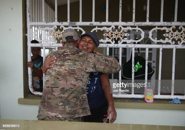 S Army 1st Special Force Command SFC Antonio Santini hugs Carmen Hernandez who is a relative of his as he works on helping people after Hurricane...