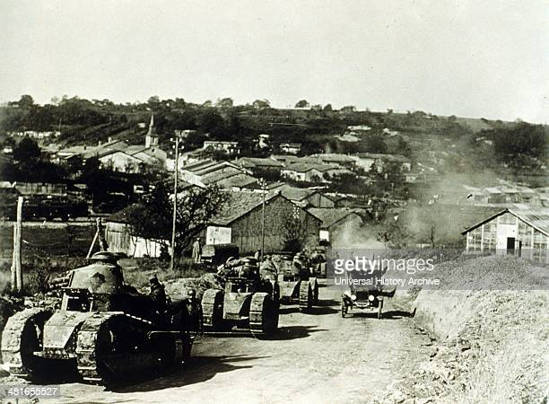 Army, 337th Co, 13 Bat 505th Reg--French tanks passing thru Rampont, France during World War I, dated 1918. Summary: Convoy of tanks leaving Rampont...