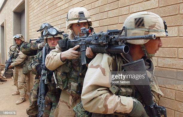 S Army 3rd Division 37 infantry soldiers advance on the VIP terminal of Baghdad International Airport during a dawn advance on the Iraqi capital...