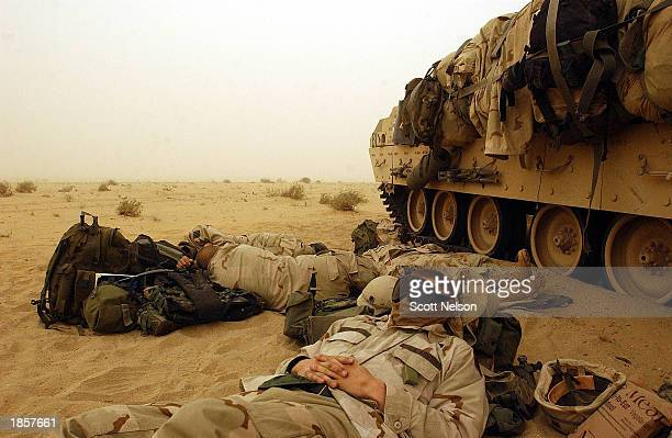 S Army 3rd Division 37 infantry soldiers rest near their Bradley fighting vehicles March 19 2003 during a hold at a forward battle position near the...