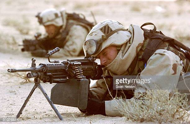 S Army 3rd Division 37 Infantry Specialist John Earle from Weymouth Massachusetts mans a frontline position with his platoon March 29 2003 near the...