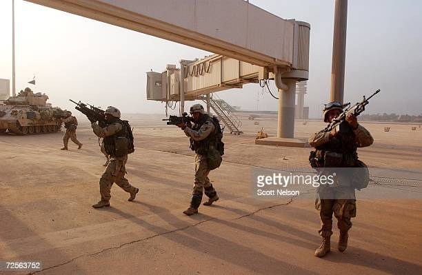 S Army 3rd Division 37 infantry troops sweep towards the main terminal of Baghdad International Airport during an allied advance April 4 2003 on the...