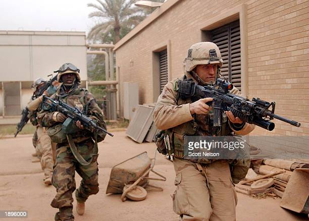 S Army 3rd Division 37 soldiers move to secure the VIP terminal of Baghdad International Airport during a dawn advance April 4 2003 on the Iraqi...