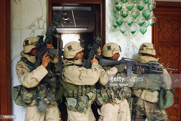 S Army 3rd Division 37 soldiers search rooms in the VIP terminal of Baghdad International Airport during an April 4 2003 dawn advance on the Iraqi...