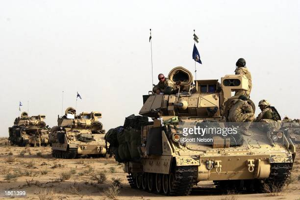 S Army 3rd Infantry Division 37 infantry squads take a brief rest March 21 2003 during their move deeper into Iraqi territory US and British forces...