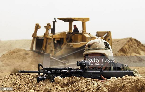 S Army 3rd Infantry Division 37 infantry troops secure an abandoned United Nations position just 75 feet from the Iraqi border March 20 2003 in the...