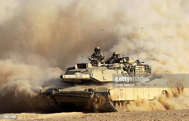 S Army 3rd Infantry Division M1/A1 Abrahms tank rolls deeper into Iraqi territory March 23 2003 south of the city of An Najaf Iraq US and British...