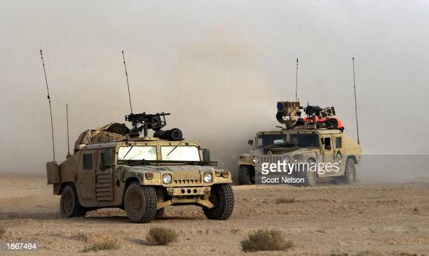 S Army 3rd Infantry Division Scout humvees move deeper into Iraqi territory March 23 2003 south of the city of An Najaf Iraq US and British forces...