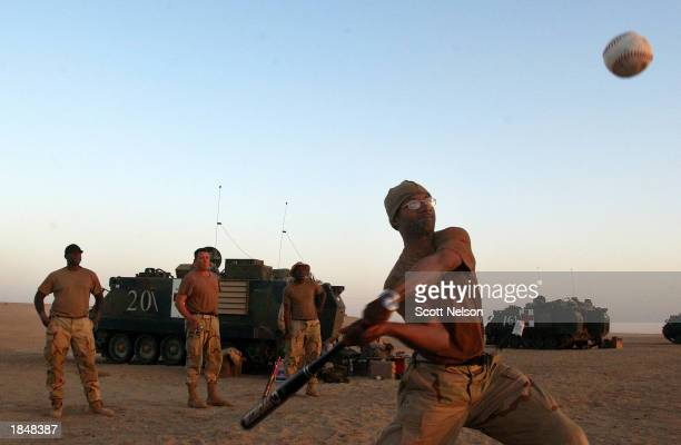 S Army 3rd Infantry Task Force 37 Sergeant Dewayne Hickman from Chattanooga Tennessee swings at a baseball during an impromptu homerun derby at his...