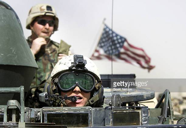 S Army 3rd Infantry Task Force 37 soldiers ride atop an armored vehicle during a training exercise near the Iraqi border March 13 2003 in northern...