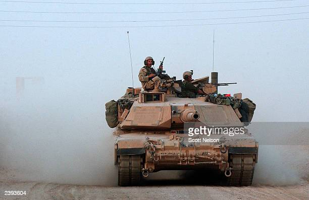 Army 4th Infantry Division, 1st Battalion, 66th Regiment Abrahms tank heads out for an evening patrol from its base August 12, 2003 in Samarra, Iraq....