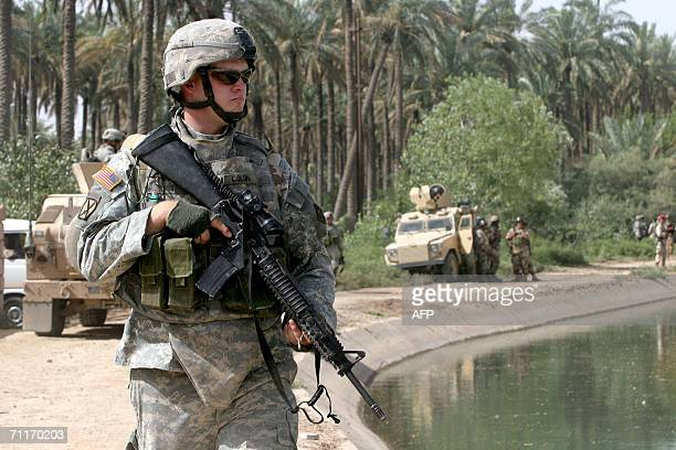 S Army 4th Infantry Division soldier guards a canal near the scene of the recent airstrike against alQaeda leader in Iraq Abu Musab alZarqawi in an...