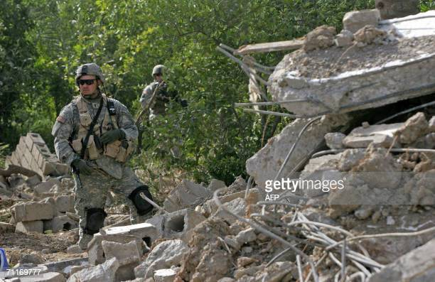 S Army 4th Infantry Division soldier guards the scene of the recent airstrike against alQaeda leader in Iraq Abu Musab alZarqawi in an isolated palm...