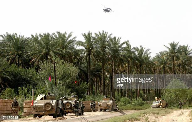 S Army 4th Infantry Division soldiers and Iraqi Army guard the scene of the recent airstrike against alQaeda leader in Iraq Abu Musab alZarqawi in an...