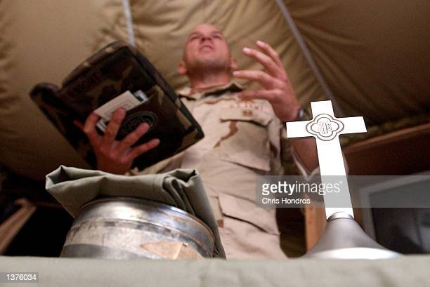 S Army 82nd Airborne chaplain Dan Knight speaks during a field worship service September 8 2002 at the Orgune Kalay forward base in Afghanistan...