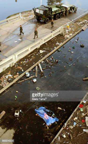 S Army 82nd Airnorne soldiers walk past the body of a drowning victim September 9 2005 in New Orleans Louisiana FEMA has asked the news media not to...