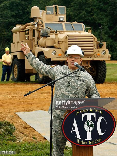 Army Aberdeen Test Center commander Col John Rooney answers questions from the news media during a demonstration of the Mine Resistant Ambush...