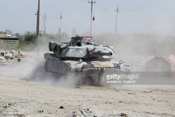 Army Abrams tank guards a meeting between Sunni and Shiite tribe leaders and clerics in alDuwanem southwest of Baghdad 25 September 2007 The aim of...