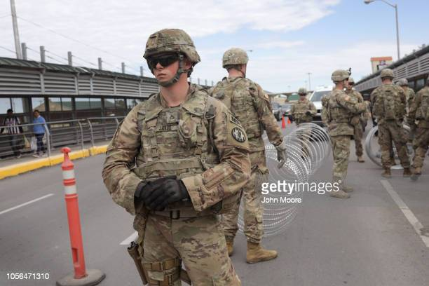 S Army active duty troops from Ft Riley Kansas 97th MP Battalion string up concertina wire at the international bridge with Mexico on November 2 2018...