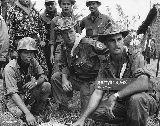 US Army Advisors and Vietnamese troop leaders check the progress of operation Dan Chi Vietnam 1964