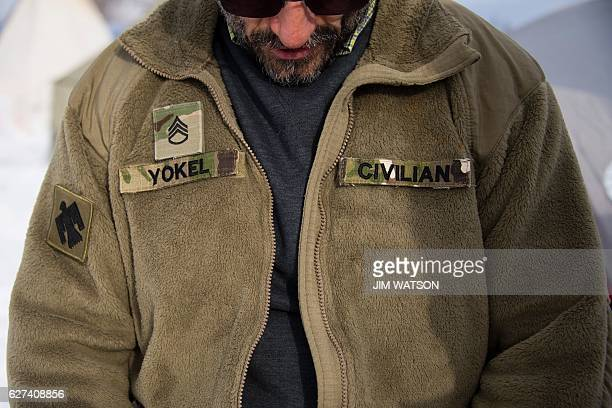 US Army Afghanistan War veteran SSGT Sal Yokel from Espanola NM zips up his fleece jacket at the Oceti Sakowin Camp on the edge of the Standing Rock...