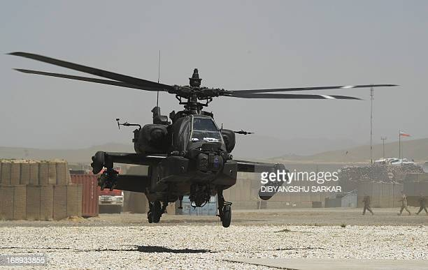 Army AH64 Apache attack helicopter of the 10th Combat Aviation Brigade lands at Forward Operating Base Ghazni on May 17 2013 USled coalition forces...
