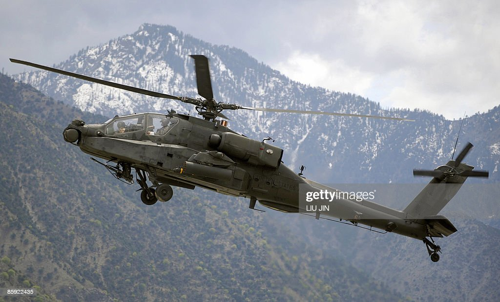 A US Army AH-64 Apache helicopter flies : News Photo