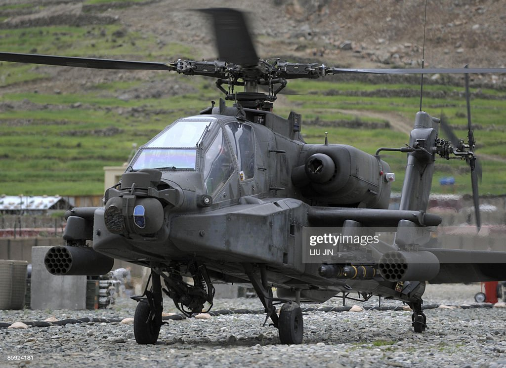 A US Army AH-64 Apache helicopter lands : News Photo