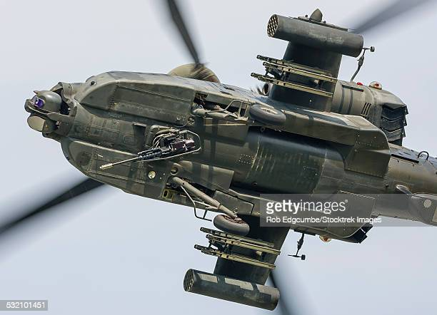 A U.S. Army AH-64D Apache Longbow pulls into a turn over Cleveland, Ohio.